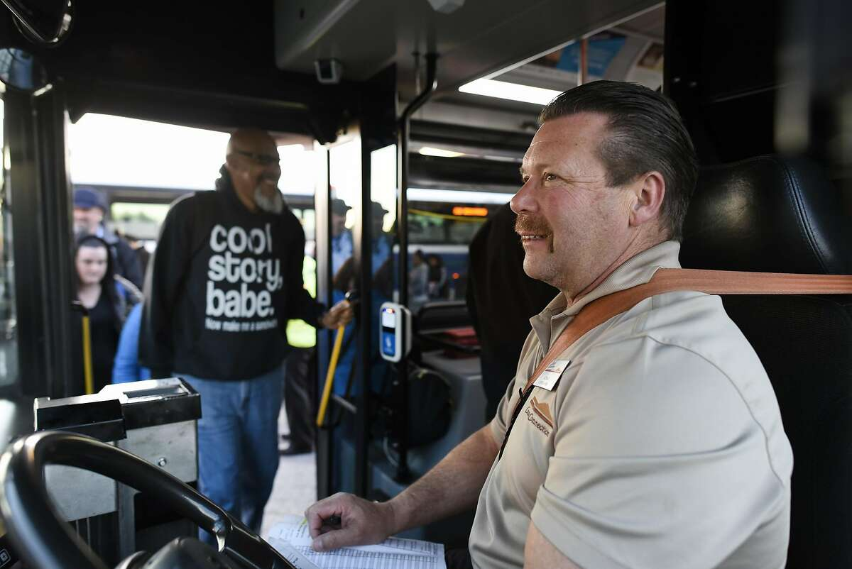 Bus driver Victor Caires of County Connection greets customers boarding his free shuttle bus at the Pittsburg/Bay Point BART station in Pittsburg, CA Thursday, March 17, 2016. Free shuttle bus service was offered as BART service was out between the Pittsburg/Bay Point and Concord stations due to an electrical problem.