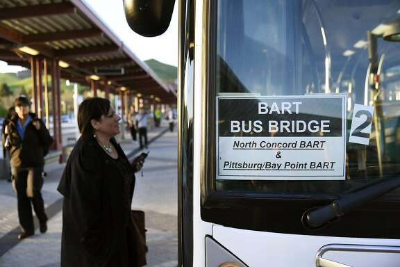 at the Pittsburg/Bay Point BART station in Pittsburg, CA Thursday, March 17, 2016.   Free shuttle bus service was offered as BART service was out between the Pittsburg/Bay Point and Concord stations due to an electrical problem.