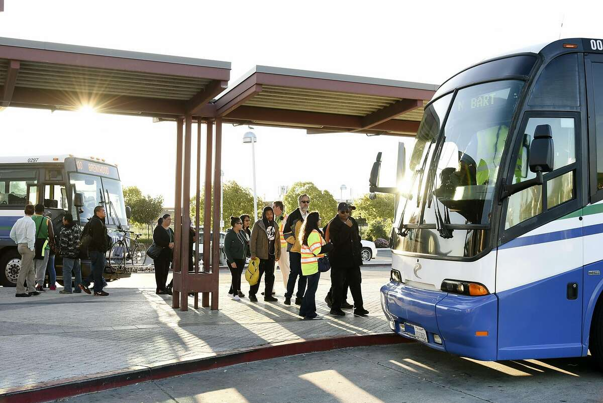 Customers line up to board free shuttle busses at the Pittsburg/Bay Point BART station in Pittsburg, CA Thursday, March 17, 2016. Free shuttle bus service was offered as BART service was out between the Pittsburg/Bay Point and Concord stations due to an electrical problem.