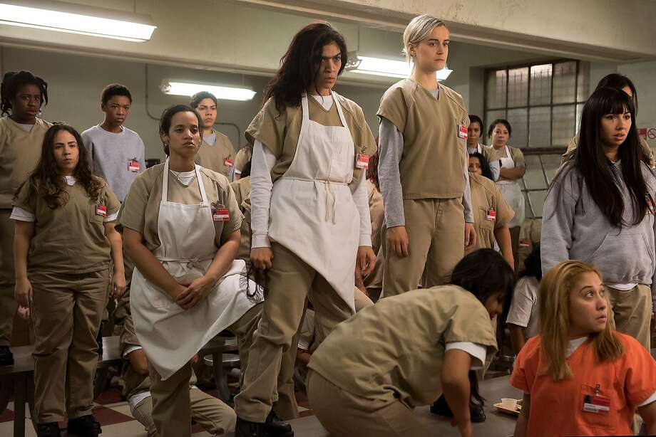 Taylor Schilling, Dascha Polanco, Samira Wiley, Uzo Aduba, Selenis Leyva, Laura Gómez, Jackie Cruz and Jessica Pimentel in a still from Orange Is The New Black season 4. Photo: Netflix