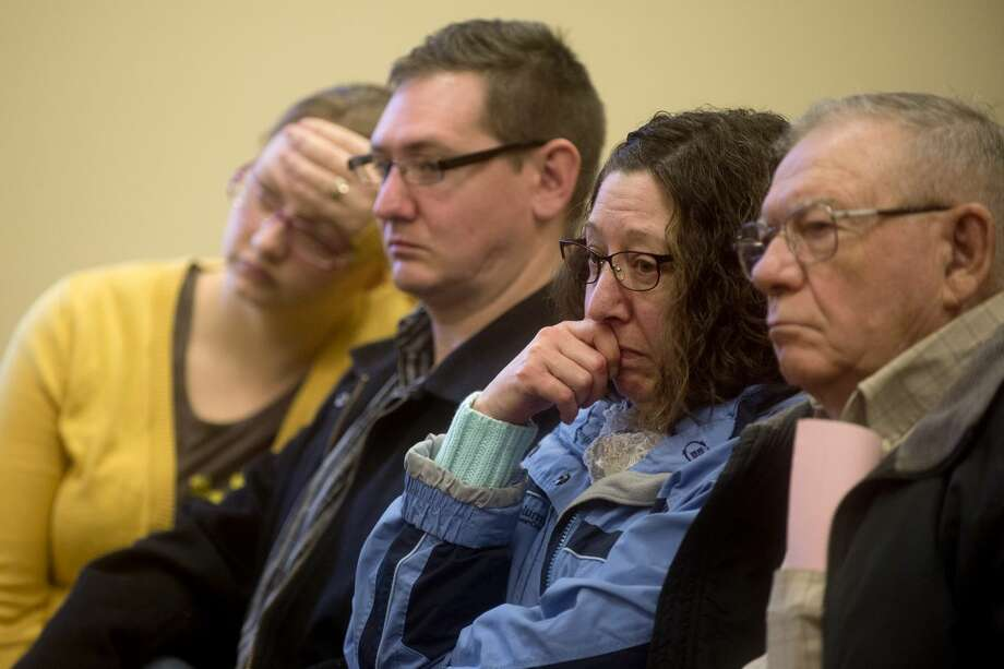 From left, Lyndsy Billington and her husband, Donald Billington Jr., both of Midland, Audrey Billington of Coleman and Jerry Billington of Shepherd listen to preliminary hearings for Gregory Allan Rose in the Midland County District Court. Rose faces charges of open murder and felony murder in connection with the Nov. 13 homicide of Connie Pajunen and the arson of her South Castor Road home. Jerry Billington was Pajunen's longtime boyfriend. Photo: Brittney Lohmiller | Midland Daily News