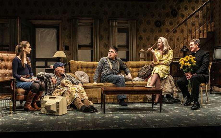 "In this image released by The New Group, Taissa Farmiga, from left, Ed Harris, Rich Sommer, Amy Madigan and Larry Pine appear in a scene from Sam Shepard's ""Buried Child,"" in New York. (Monique Carboni/The New Group via AP) Photo: Monique Carboni"