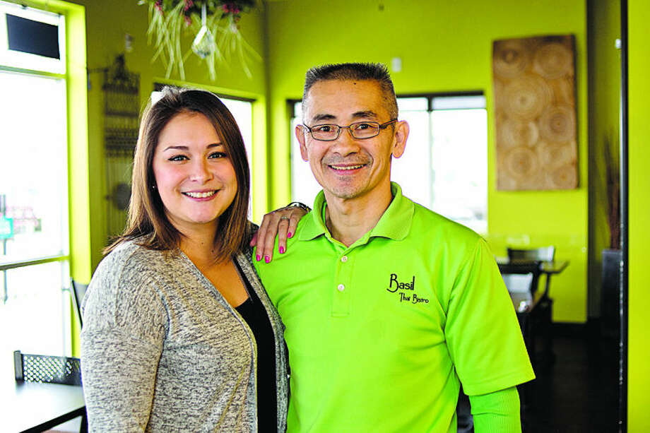 Two of the owners of Basil Thai Bistro daughter Sami Ung, left, and father Hugh Miller. Photo: Nick King/Midland Daily News