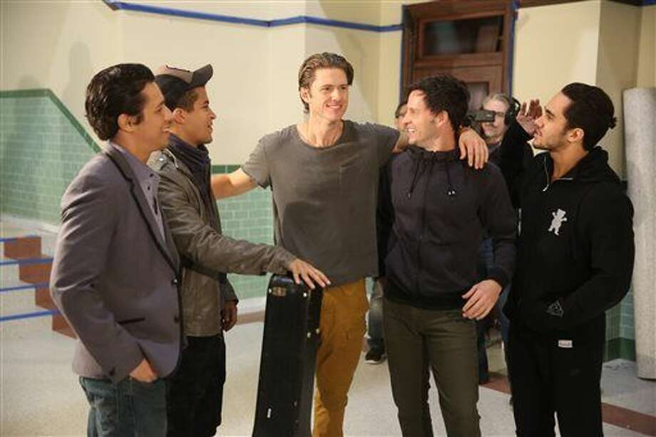"This image released by Fox shows, from left, David Del Rio, Jordan Fisher, Aaron Tveit, Aaron Call, and Carlos PenaVega during a rehearsal for, ""Grease:Live,"" airing Sunday, Jan. 31, at 7p.m. (Kevin Estrada/FOX via AP) Photo: Kevin Estrada"