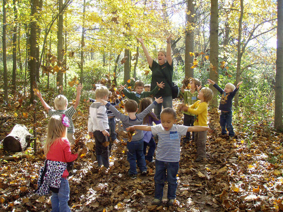 Nature Preschool children regularly hike to wooded areas, ponds, fields and the Homestead Farm, exploring the natural world. Photo: Photo Provided