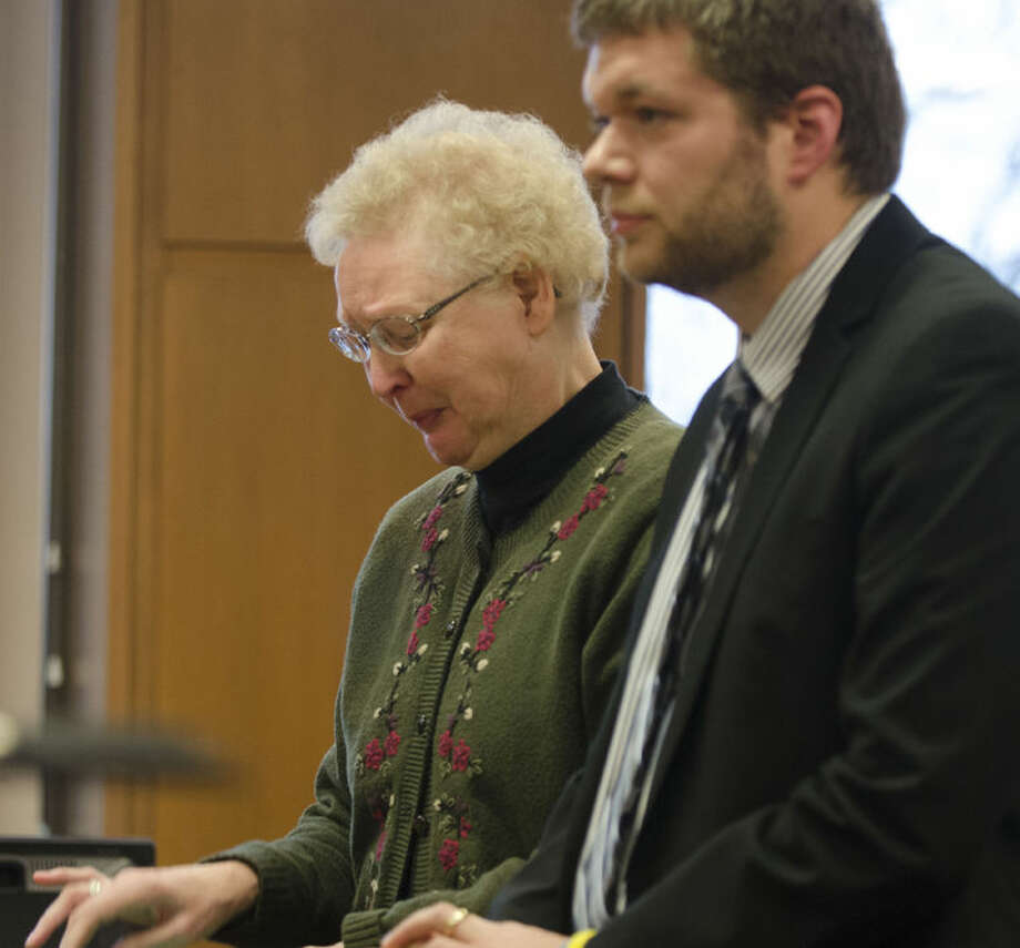 Shirley Thoen, 59, a former early childhood special education teacher in the Port Huron school district, reads a statement during her sentencing, Thursday, Jan. 14, 2016, in Port Huron, Mich. Thoen., who pleading guilty in December to two counts of assault and battery of her students, was sentenced to 93 days in jail, with 73 days suspended upon completion of probation. (Mark R. Rummel/The Times Herald via AP) NO SALES; MANDATORY CREDIT Photo: Mark R. Rummel