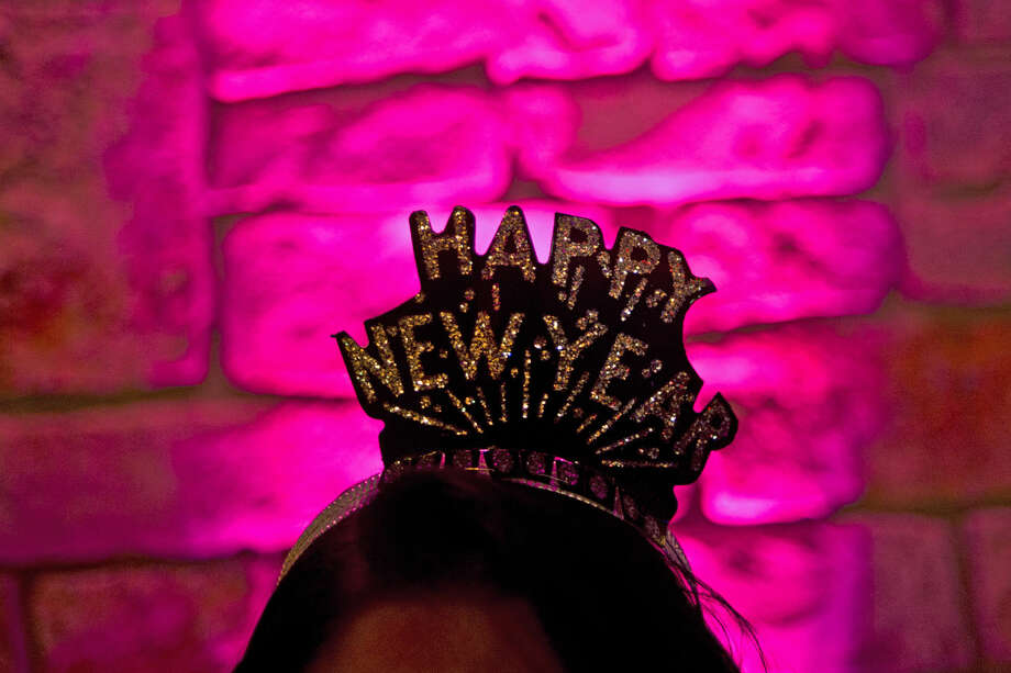ERIN KIRKLAND | ekirkland@mdn.net Mt. Pleasant resident Carol Slater shows off her tiara before ringing in the new year on Thursday during Midnight on Main at Dow Diamond. Photo: Erin Kirkland/Midland Daily News
