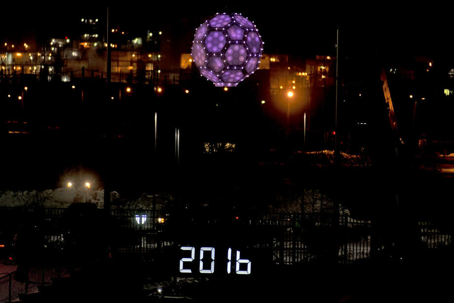 ERIN KIRKLAND | ekirkland@mdn.net The ball drops as the clock strikes midnight on Friday during Midnight on Main at Dow Diamond. Photo: Erin Kirkland/Midland Daily News
