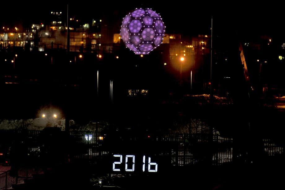 ERIN KIRKLAND | ekirkland@mdn.net The ball drops as the clock strikes midnight on Friday during Midnight on Main at Dow Diamond. Photo: Erin Kirkland/Midland Daily News