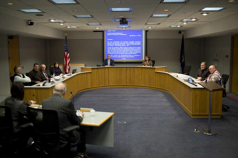 The Midland County Board of Commissioners and other county officials are shown at a meeting in this Daily News file photo