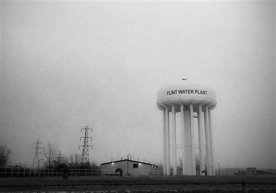 This Jan. 21, 2016 photo shows the water tower at the Flint, Mich., water plant. Flint's mayor has floated a shockingly high price to fix the city's lead-contamination problem, saying it could millions to replace damaged pipes. (Perry Rech/American Red Cross via AP) Photo: Perry Rech