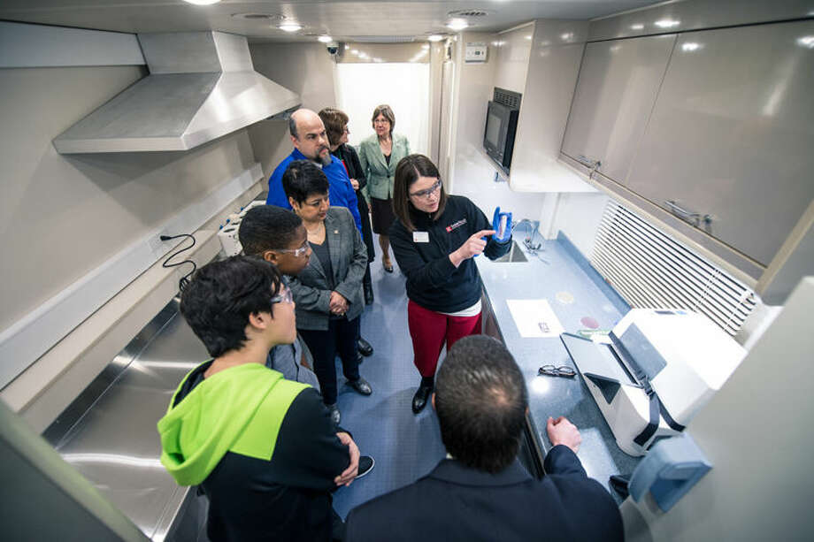 Tami Sivy, Saginaw Valley State University associate professor of chemistry, explains the lab's water quality testing capabilities to students from White Pine Middle School in Saginaw Township and others. Photo: Photo Provided