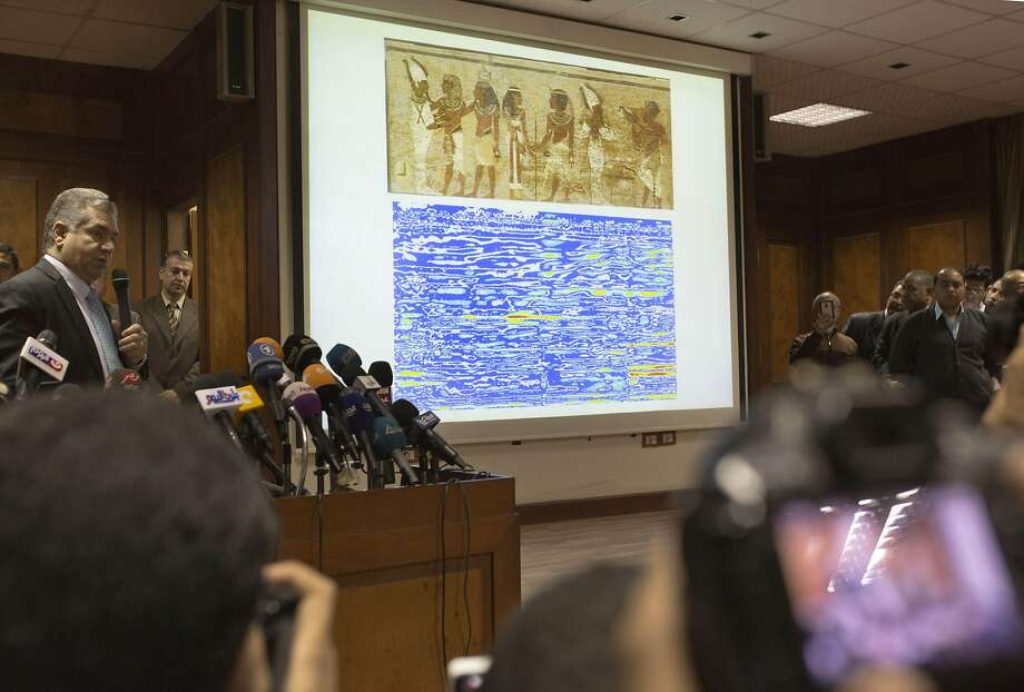 Antiquities Minister Mamdouh el-Damaty displays radar scan images of the burial chamber in Cairo. Photo: Amr Nabil, AP