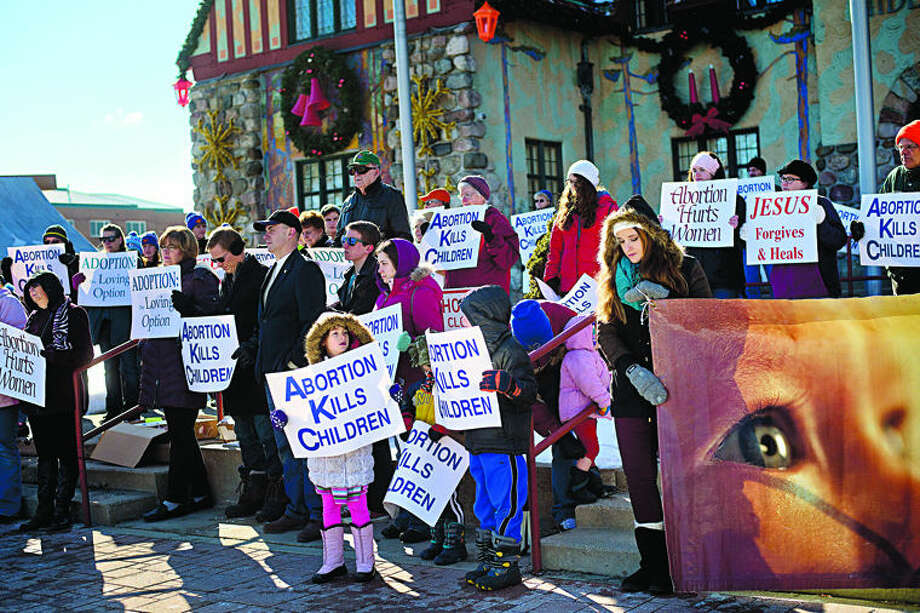 A crowd gathers in front of the Midland County Courthouse during a Right to Life vigil on Saturday in Midland. Photo: Nick King/Midland Daily News