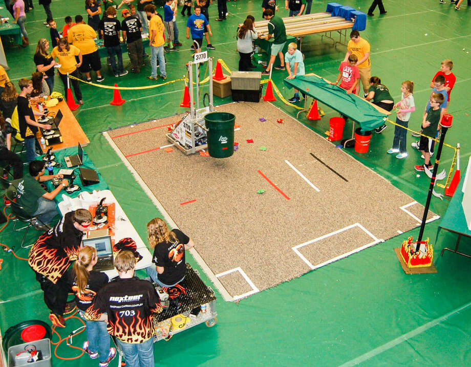 Dow and Bullock Creek high schools host a friendly competition between robots during a STEM Festival. Midland Public Schools will receive $3 million in grants to support its STEM (science, technology, engineering and math) strategic plan over the next three years. Photo: Daily News File Photo