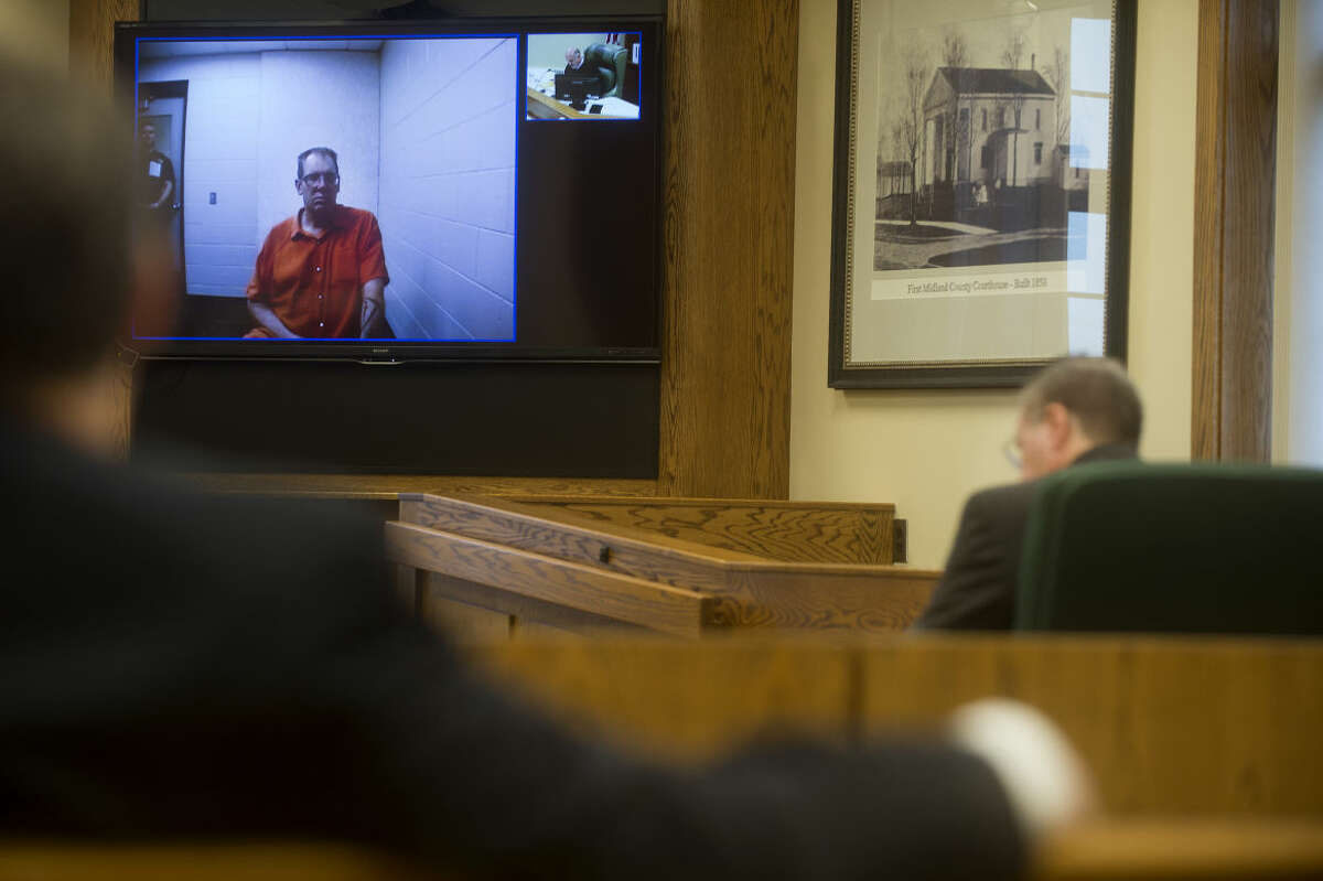 Gregory Allan Rose, shown in the television monitor, was arraigned on multiple charges in connection with a case of homicide and arson Wednesday afternoon.