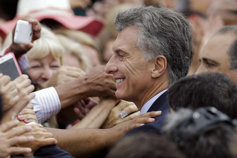 Supporters hug Argentina's President Mauricio Macri as he leaves Congress after giving his first annual State of the Nation address in Buenos Aires early this month. Photo: Victor R. Caivano, AP