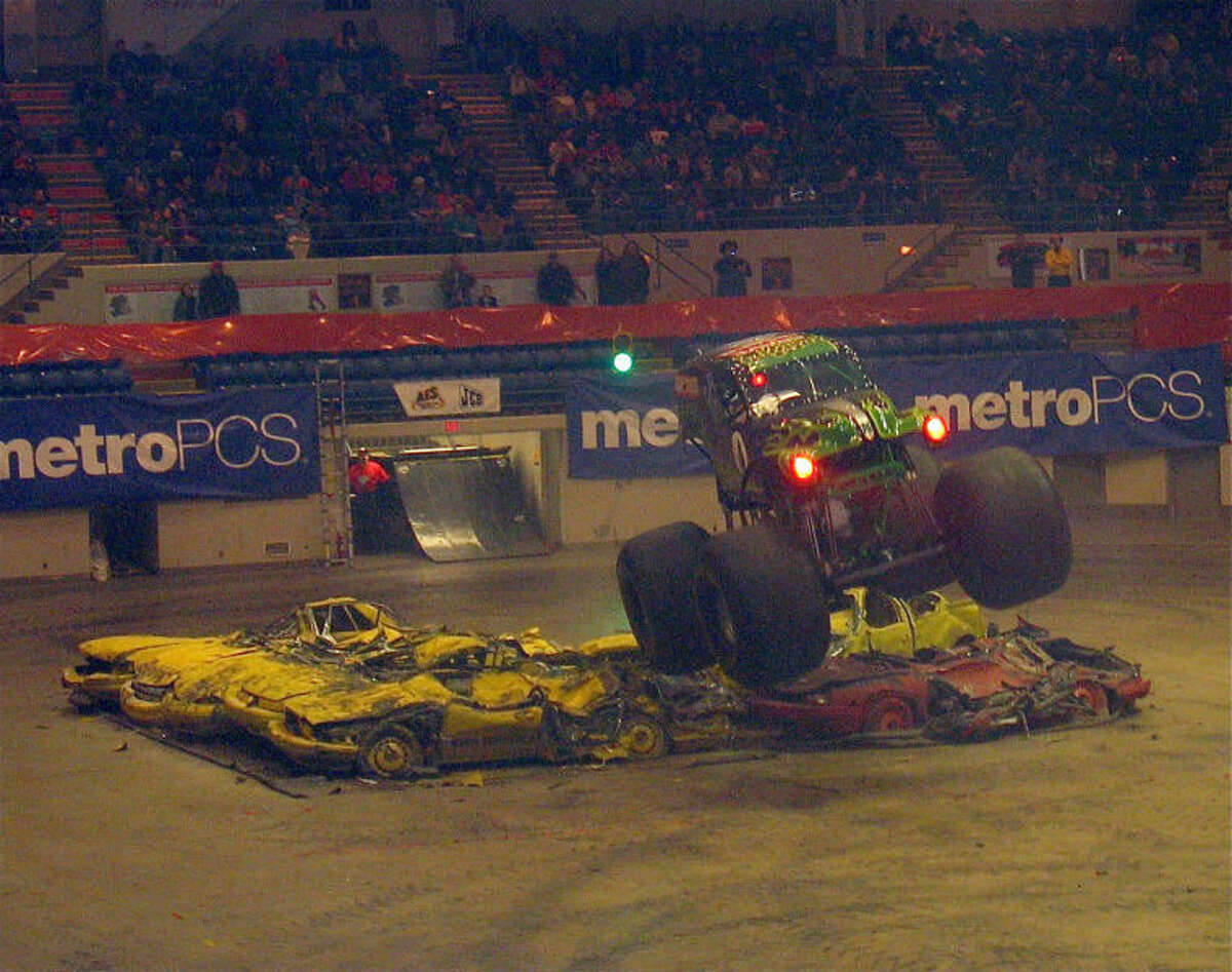 STUART FROHM for the Daily NewsGrave Digger goes airborne after passing over wrecked cars during the Saturday afternoon Monster Jam show at the Dow Event Center in Saginaw.