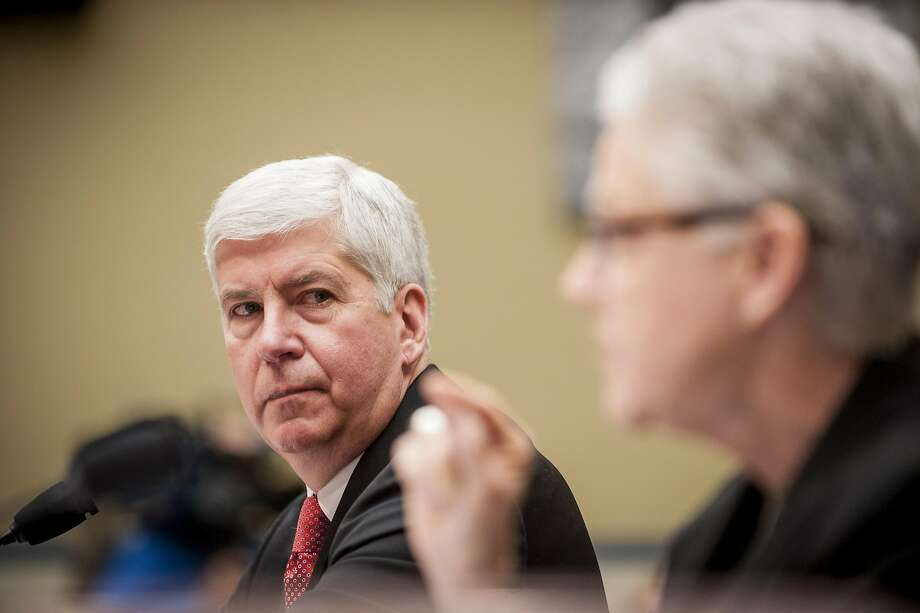 Gov. Rick Snyder watches as Gina McCarthy, administrator of the U.S. Environmental Protection Agency, testifies. Photo: Pete Marovich, Bloomberg