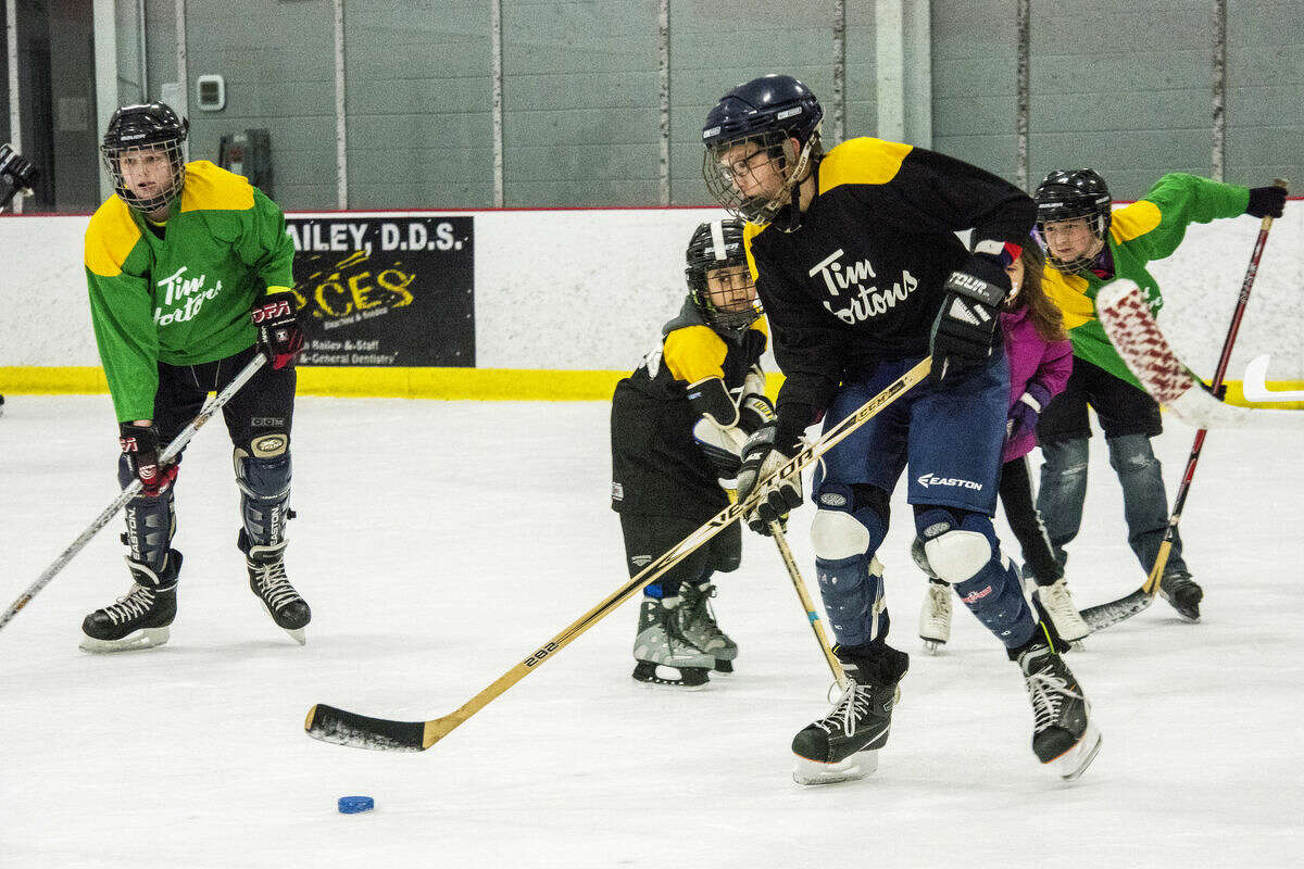 """Mark Krudy, 13, of Midland, plays hockey during Try Hockey for Free Day, an event hosted by the Midland Amateur Hockey League at the Midland Civic Arena. """"I play [hockey] on our pond, but I've never been on a team,"""" Krudy said. """"It was great."""""""