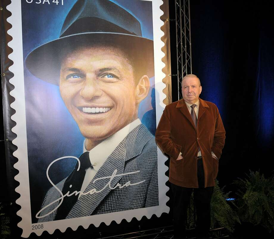 Frank Sinatra Jr. poses in 2007 in front of a U.S. Postal Service stamp in tribute to his father, in Beverly Hills. He said he was not bitter about not having repeated his father's success. Photo: GABRIEL BOUYS, AFP/Getty Images