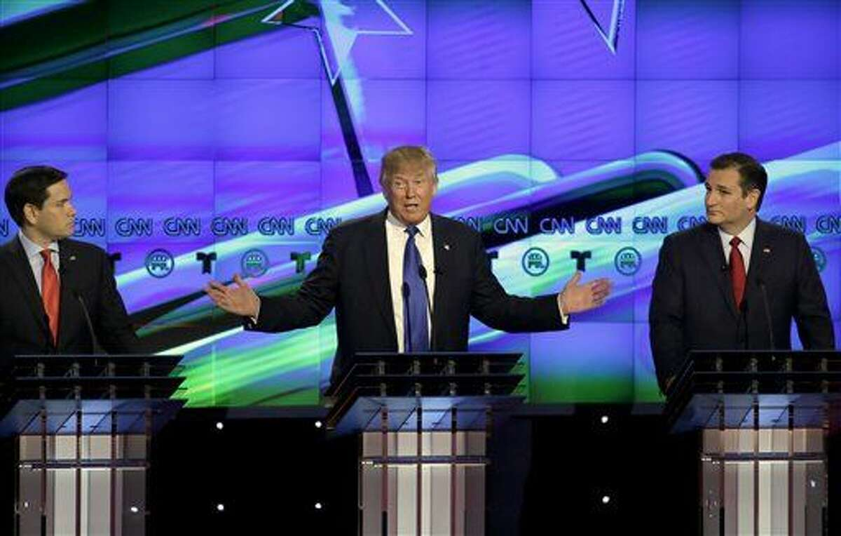 Republican presidential candidate, businessman Donald Trump, center, speaks as Republican presidential candidate, Sen. Marco Rubio, R-Fla., left and Ted Cruz, R-Texas look on during a Republican presidential primary debate at The University of Houston, Thursday.