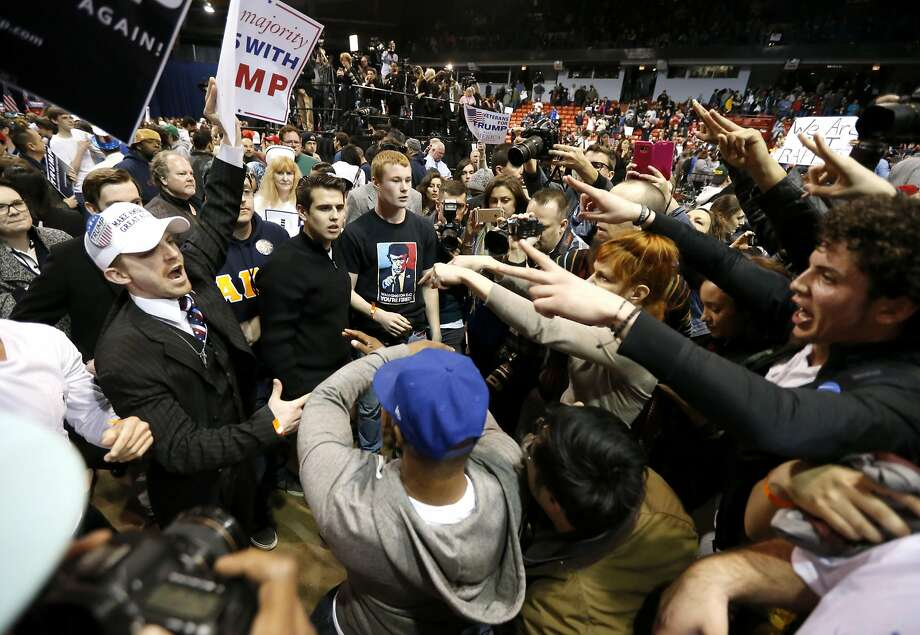 Supporters of GOP presidential candidate Donald Trump (left) face off against protesters after a rally at the University of Illinois-Chicago was canceled over security concerns on March 11. Photo: Charles Rex Arbogast, AP