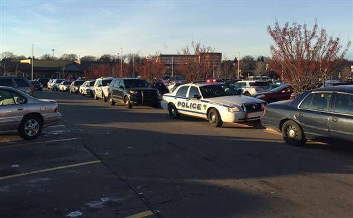 In this photo provided by NBC15 Madison, authorities respond to reports of shots fired at the East Towne Mall in Madison, Wis., Saturday, Dec. 19, 2015. (Sharon Yoo/NBC15 Madison via AP)