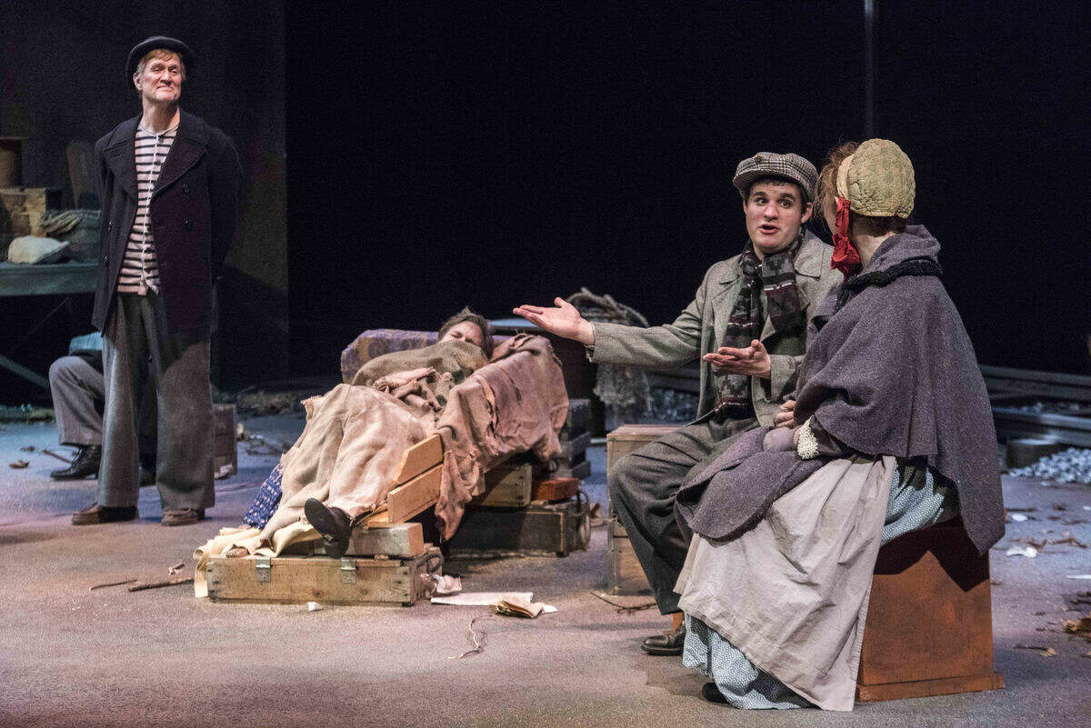 From right, Peter Brooks and Katie Cook listen as Jacob Hare tells Alex Sedrowski about a mysterious gentleman who buys him Christmas dinner each year as they rehearse a scene from An O. Henry Christmas at the Midland Center for the Arts.
