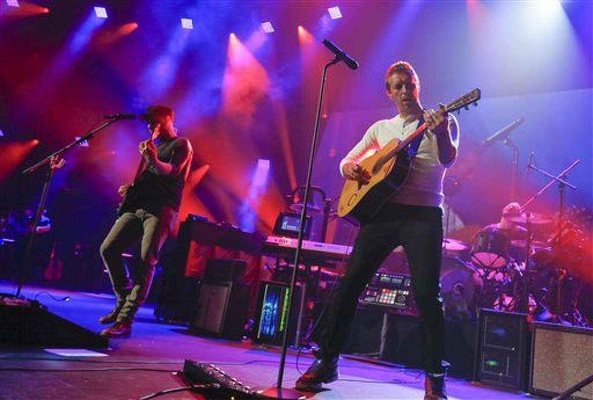 FILE - In this March 11, 2014 file photo, Coldplay performs at the iTunes Festival during the SXSW Music Festival in Austin, Texas. Coldplay will perform at the Pepsi Super Bowl 50 Halftime Show on CBS Sunday, Feb. 7, 2016, the NFL announced on Thursday, Dec. 3, 2015.