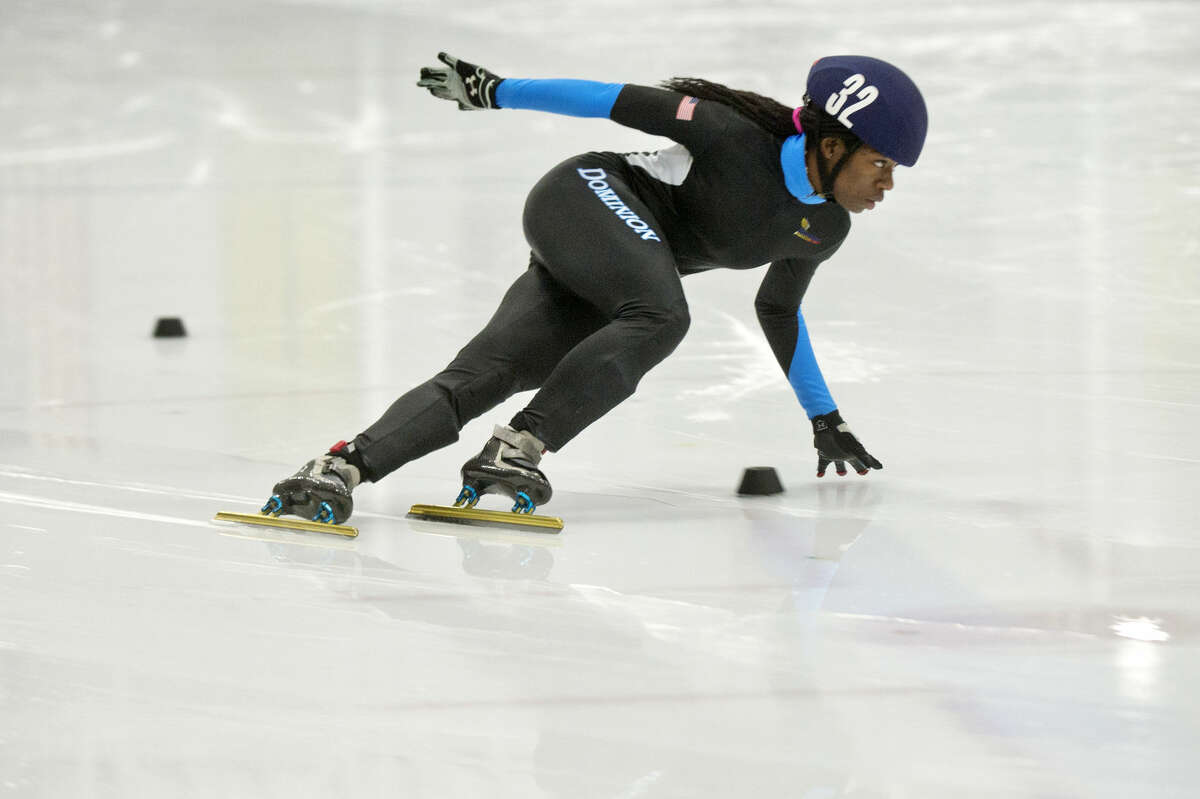 Maame Biney turns a corner while competing in a heat of the 1000 meter semifinals race during the U.S. Speedskating Junior Championships and Junior Olympic Qualifier on Sunday at the Midland Civic Arena. Biney finished first in the overall female standings to earn one of four spots in the Junior World Championships next month in Bulgaria.