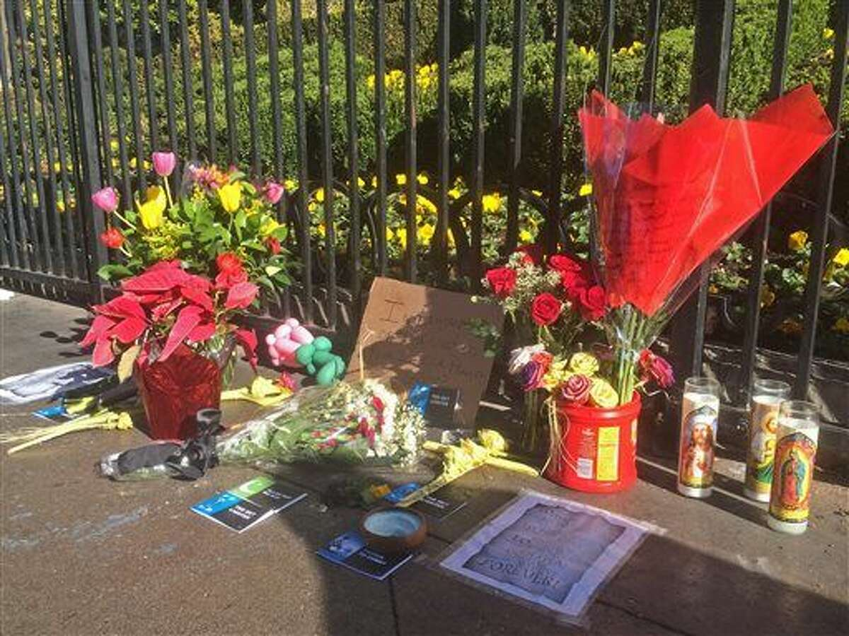 A makeshift memorial for crash victims appears on the strip in Las Vegas on Tuesday, Dec. 22, 2015. A woman accused of intentionally plowing a car carrying her young daughter through crowds of pedestrians on the Las Vegas Strip was charged Tuesday with murder, child abuse and hit-and-run. The crash killed Jessica Valenzuela, 32, of Buckeye, Ariz., and injured at least 35 people. Three were still in critical condition Tuesday and five others remained hospitalized. (AP Photo/Brian Skoloff)