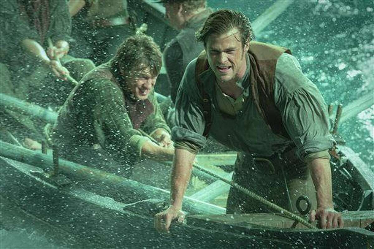 """This photo provided by Warner Bros. Pictures shows Chris Hemsworth, right, as Owen Chase, and Sam Keeley as Ramsdell, left, in a scene from the film, """"In the Heart of the Sea."""" The movie opened in U.S. theaters Friday."""