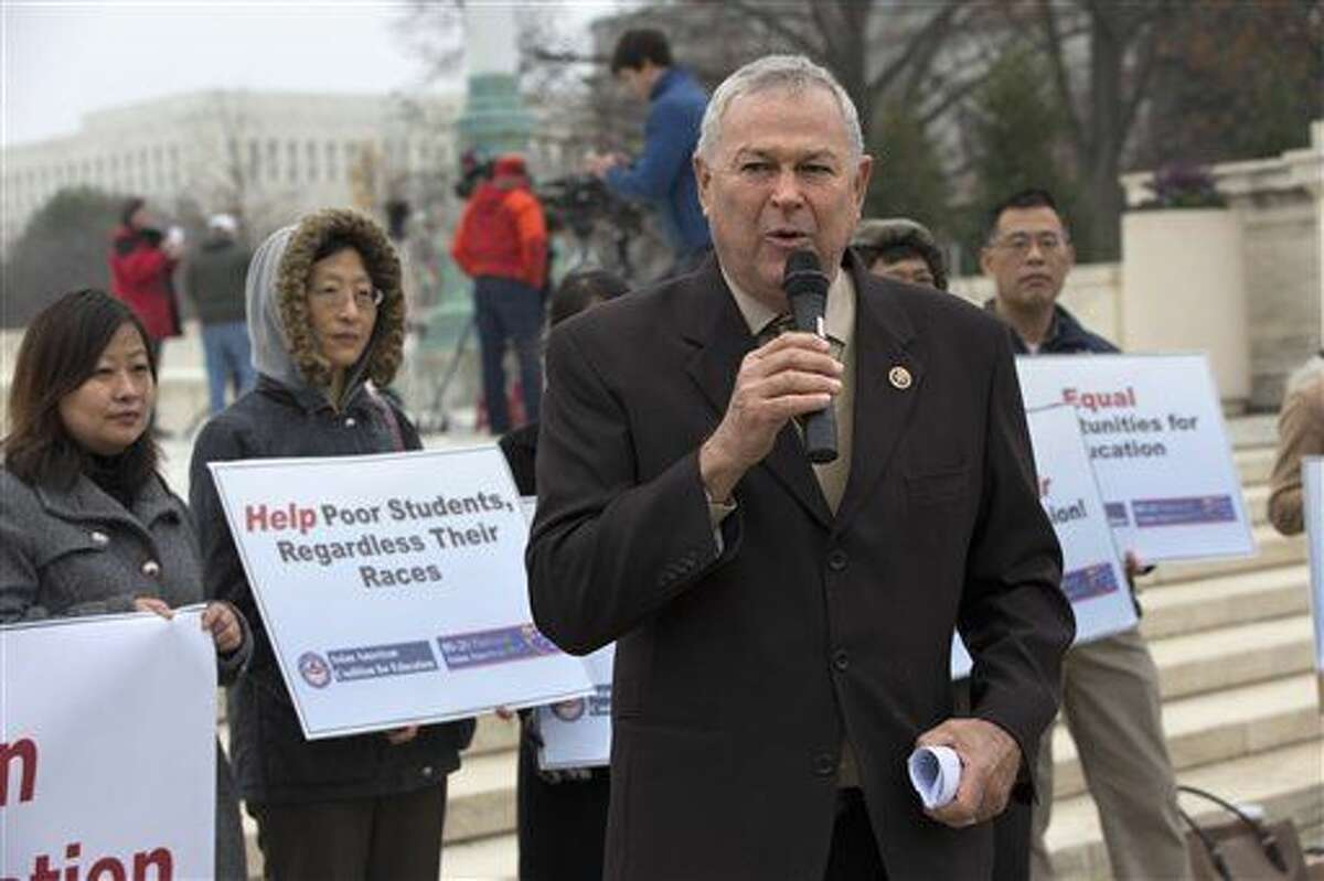 Rep. Dana Rohrabacher, R-Calif., speaks in solidarity with the Asian American Coalition for Education as they protest against racial quotas during a rally outside the Supreme Court in Washington, Wednesday, Dec. 9, 2015, as the court hears oral arguments in the Fisher v. University of Texas at Austin affirmative action case. (AP Photo/Jacquelyn Martin)