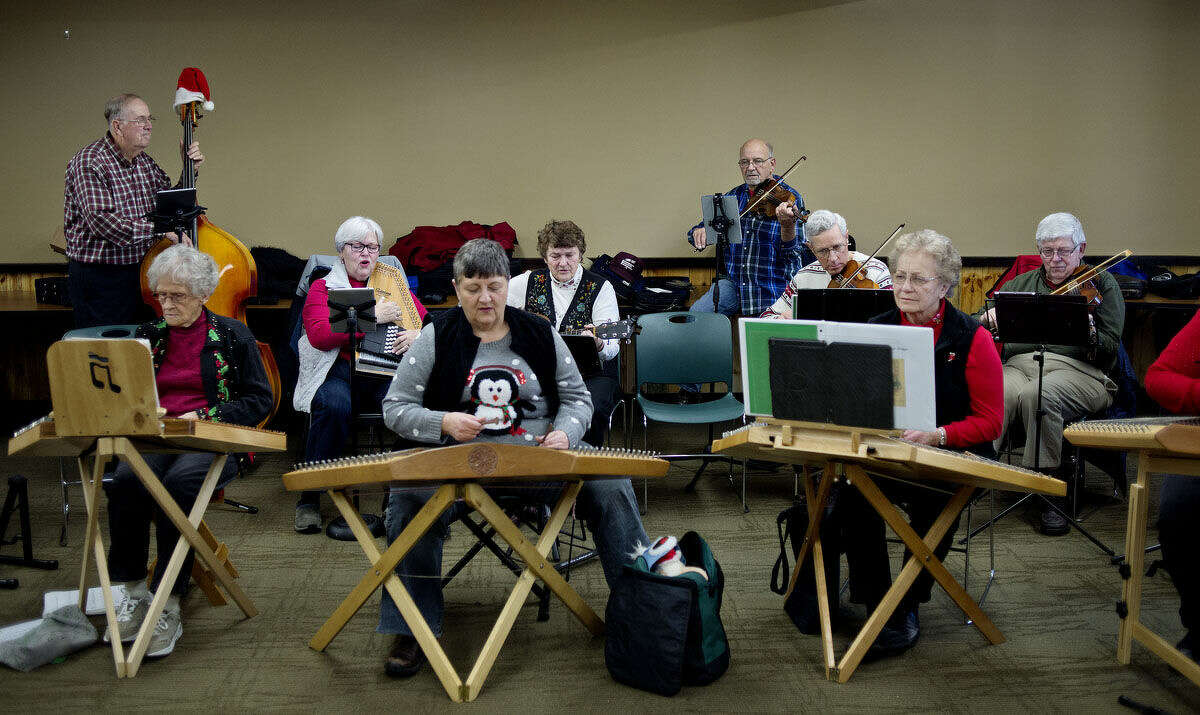 Members of The Jolly Hammers & Strings perform at the Chippewa Nature Center on Saturday at the Chippewa Nature Center as part of their monthly jam session.