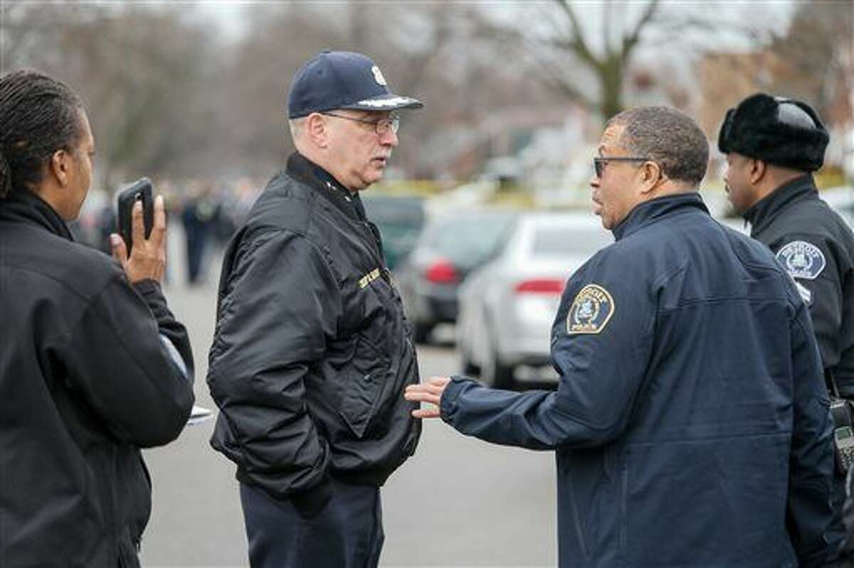 Dearborn Police Chief Ronald Haddad, left, and Detroit Police Chief James Craig speak at the scene of a fatal shooting of an unarmed man involving a Dearborn Police officer on the westside of Detroit on Wednesday, Dec. 23, 2015. An unarmed black man who was fatally shot by suburban Detroit police suffered from mental illness and wasn't a threat to officers, his mother said Thursday, Dec. 24, 2015. (Kimberly P. Mitchell/Detroit Free Press via AP)