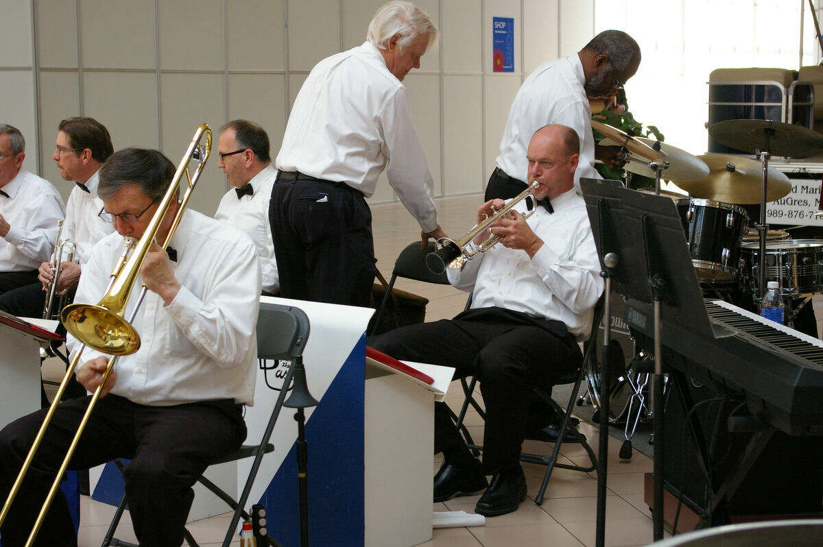 Niky House For the Daily News.The brass section, as well as the drummer for Blast From the Past, get ready for their performance at the Midland Mall.