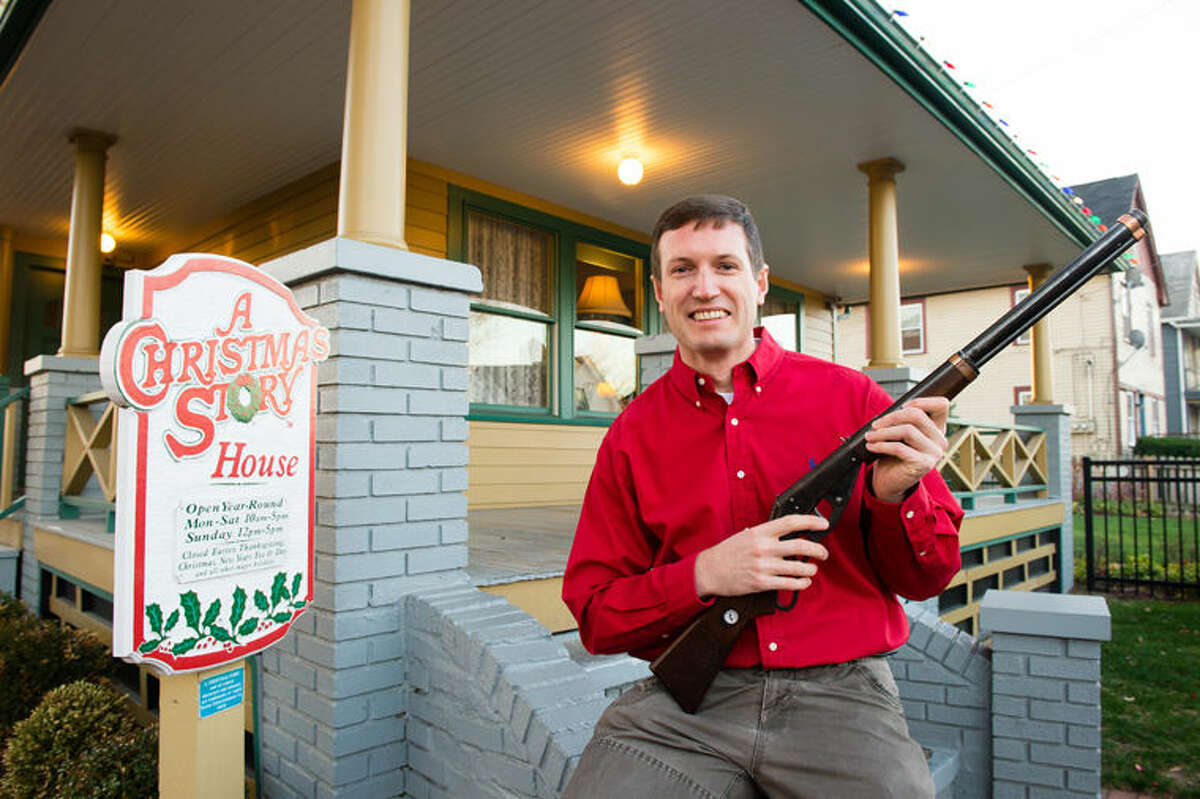 In this image released on Wednesday, Dec. 2, 2015, Museum owner Brian Jones holds the Red Ryder BB Gun used in the movie at A Christmas Story House and Museum in Cleveland. The Museum has recently acquired the movie prop and added it to their collection. (Jason Miller/AP Images for A Christmas Story House and Museum)
