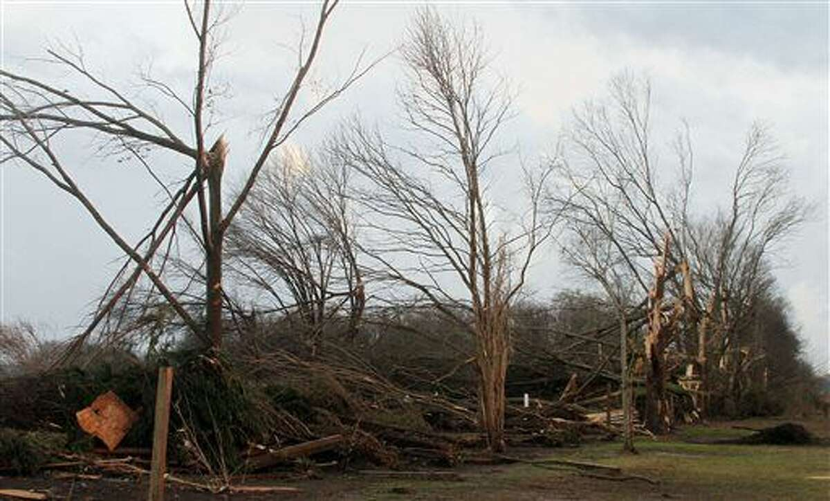 """Damaged trees are seen in the Roundaway community near Clarksdale, Miss., Wednesday, Dec. 23, 2015. A storm system forecasters called """"particularly dangerous"""" killed multiple people as it swept across the country Wednesday. (Troy Catchings/The Press Register via AP)"""