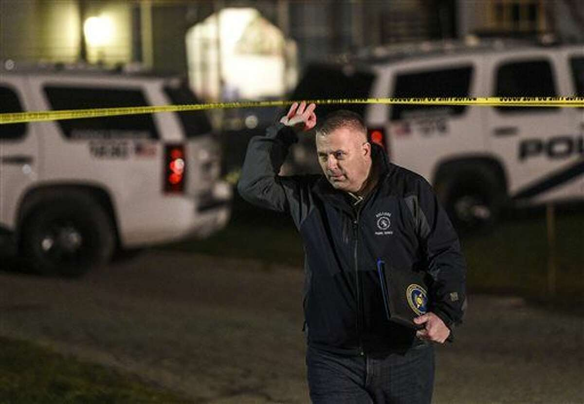 In this photo taken on Monday evening, Dec. 7, 2015, Holland Police Captain Jack Dykstra leaves the crime scene to speak with media while investigating a double fatal shooting of a man and a woman in Holland, Mich. (Taylor Ballek /The Grand Rapids Press via AP) ALL LOCAL TELEVISION OUT; LOCAL TELEVISION INTERNET OUT; MANDATORY CREDIT