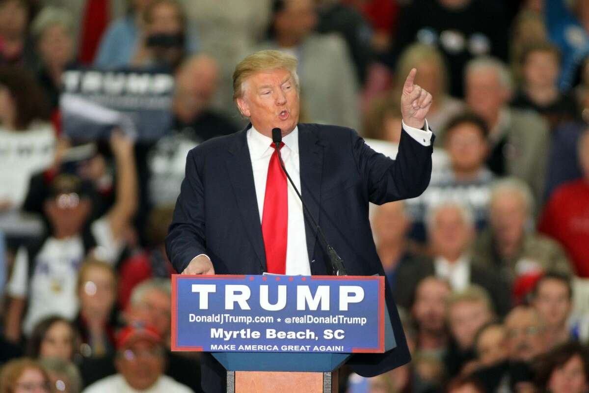 """Republican presidential candidate Donald Trump is shown speaking during a campaign event at the Myrtle Beach Convention Center on Tuesday. Trump denied Thursday that he mocked a reporter with a disability in a South Carolina speech, despite appearing to imitate mannerisms of the """"poor guy"""" and make fun of him."""