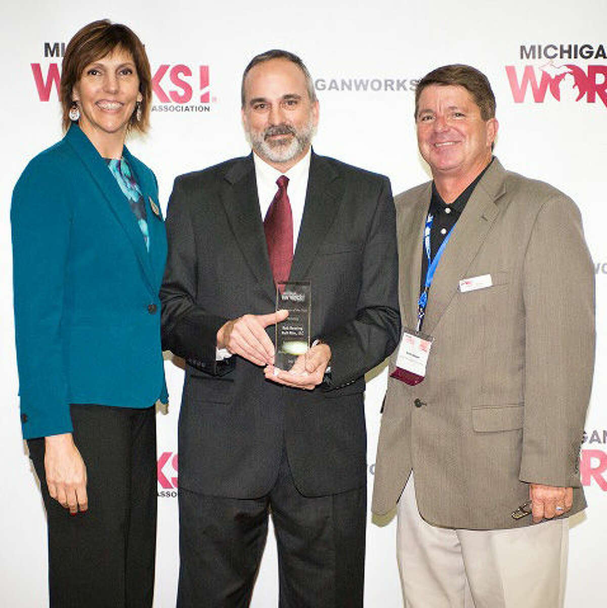 Pictured are Luann Dunsford, Michigan Works Volunteer of the Year Rob Neering and Mark Berdan.