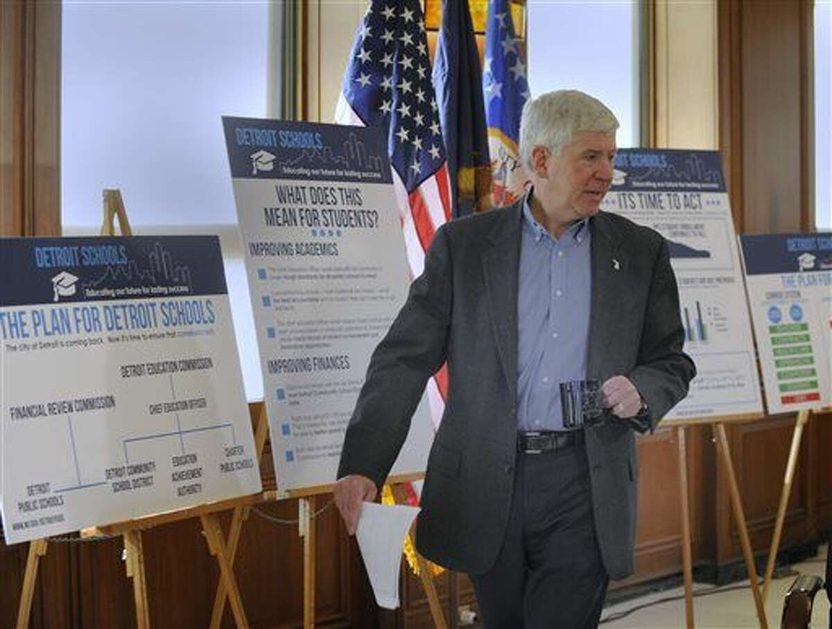 Michigan Gov. Rick Snyder talks about his plan for Detroit Public Schools in this file photo. Snydersaid in a statement Sunday that the state is postponing efforts to accept refugees until federal officials fully review security clearances and procedures.