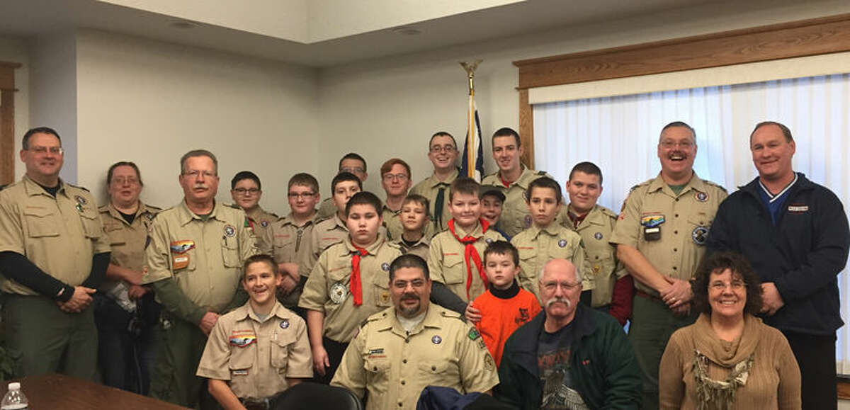 Local Boy Scouts helped deliver the Christmas food baskets to families for their meals on Christmas day.