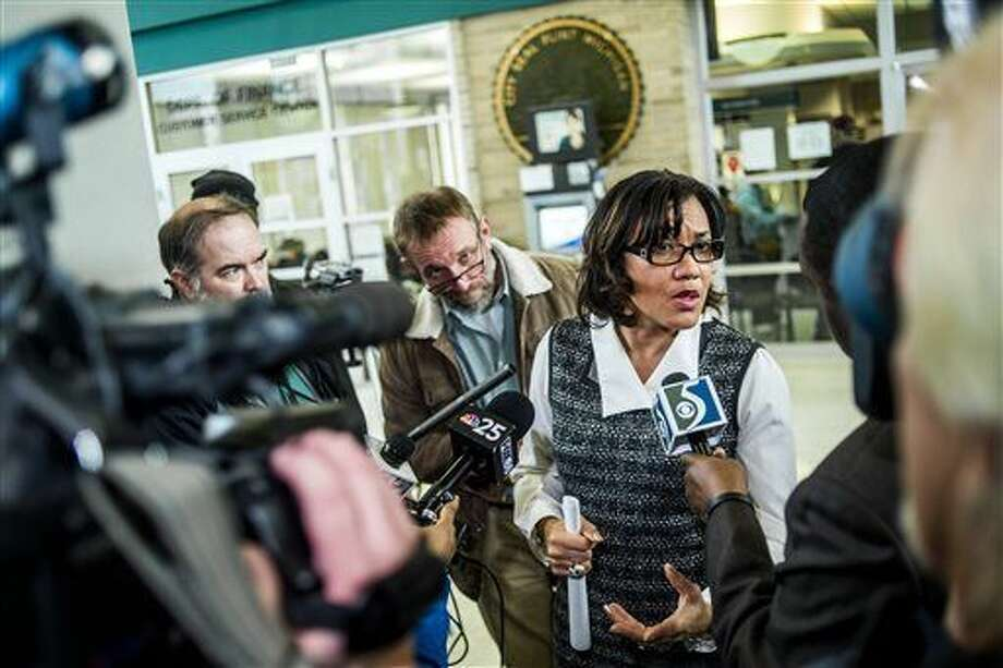 A swarm of reporters surround Flint Mayor Karen Weaver to ask question after a news conference at City Hall in Flint.A new study provides the strongest evidence yet of a link between elevated blood-lead levels in children living in Flint and the struggling city's water system, a pediatrician who first raised alarms about the matter said Monday. Photo: Jay May | Flint Journal Via AP