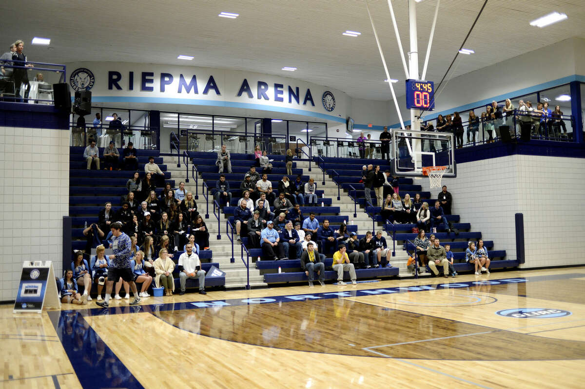 Staff unveiled the new name, Riepma Arena, for the Bennett Sports Center area during halftime during the Northwood women's game against Wayne State during on Thursday. The arena was named after the late football coach Pat Riepma.