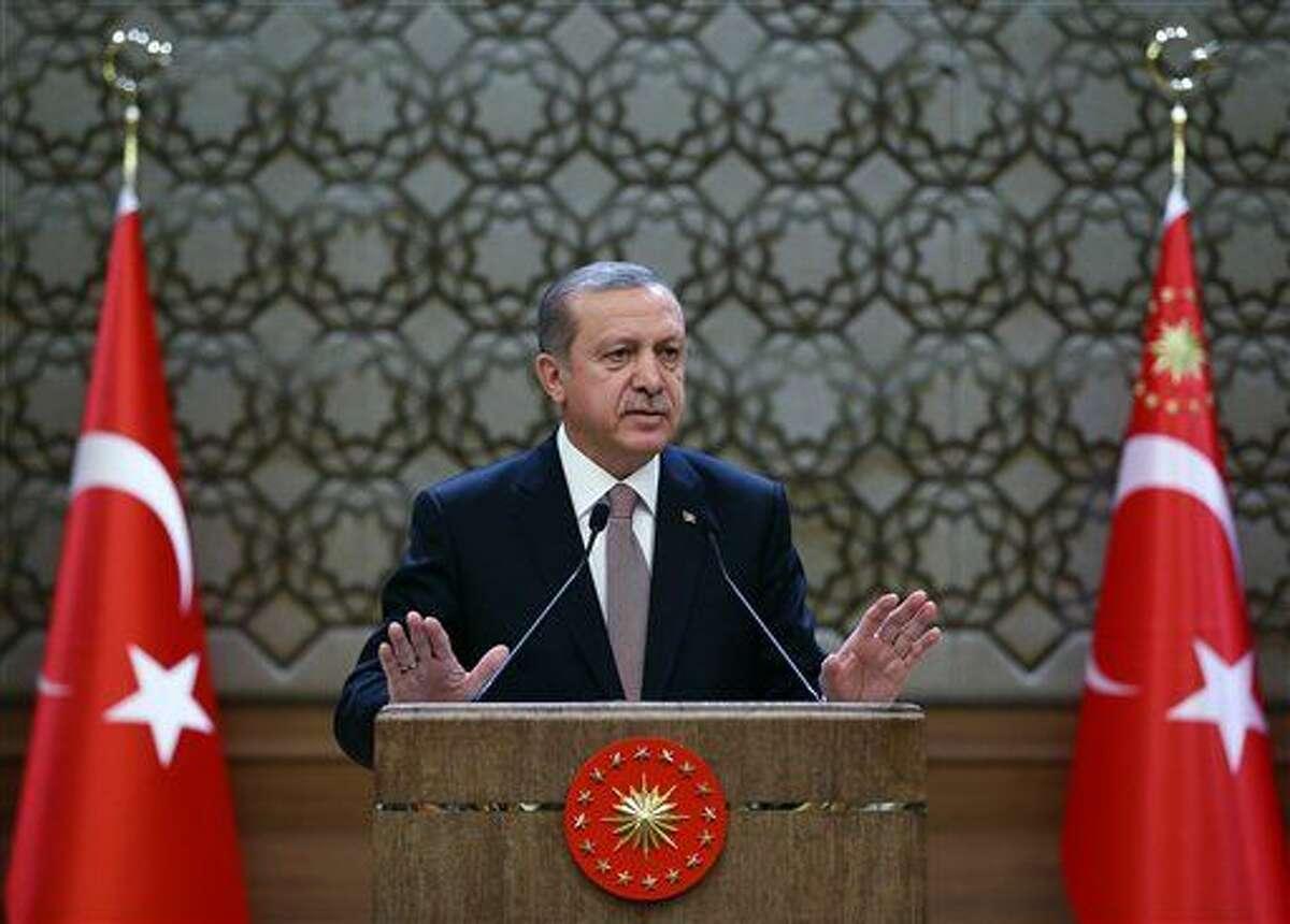 Turkish President Recep Tayyip Erdogan addresses a meeting of local administrators at his palace in Ankara, Turkey, Thursday.