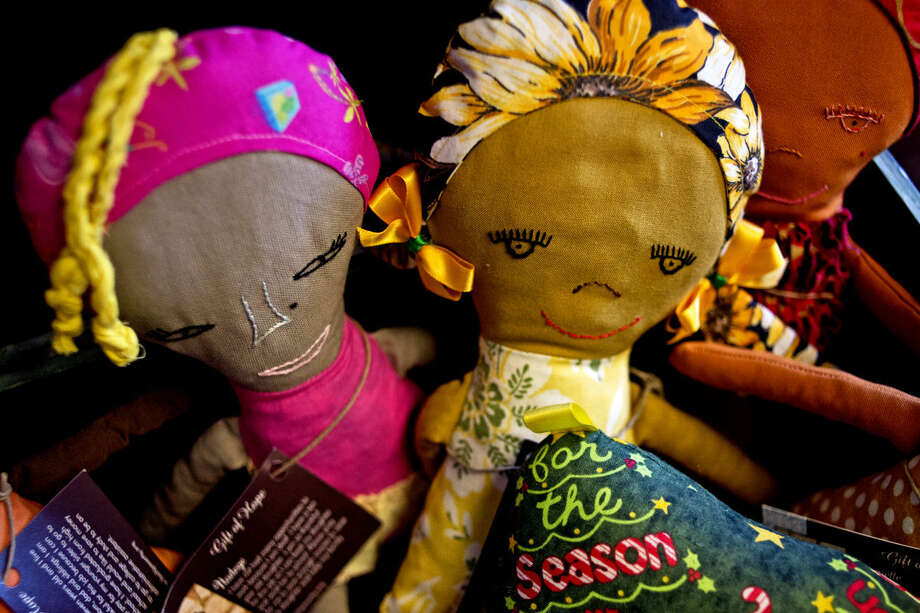 Dolls sit on display at Gift of Hope Boutique in downtown Midland. The store sells