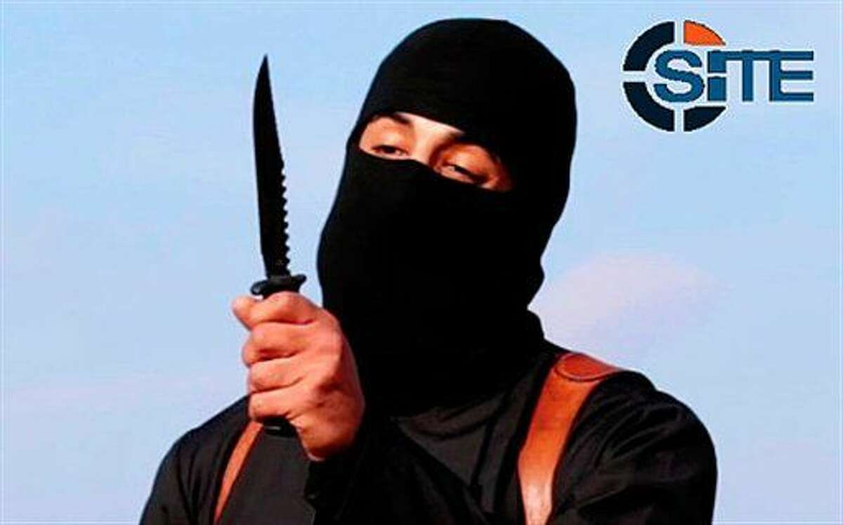 """This image made from militant video shows Mohammed Emwazi, known as """"Jihadi John,"""" holding a knife. A U.S. drone strike targeted a vehicle in Syria believed to be transporting the masked Islamic State militant known as """"Jihadi John"""" on Thursday."""