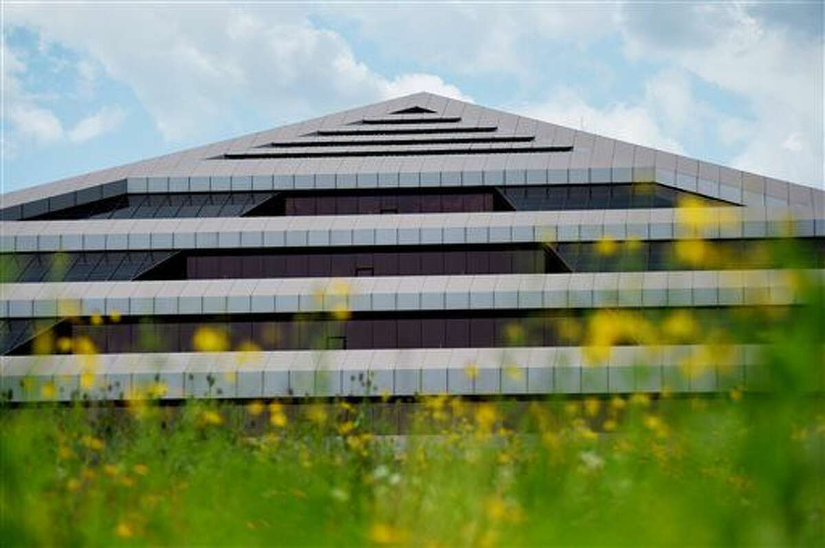 This July 25, 2015 photo shows a pyramid-shaped building formerly owned by Steelcase Inc. in Gaines Township near Grand Rapids, Mich. Switch, a major Internet data center developer, would be in the building as the state Senate on Thursday, Dec. 3, narrowly approved lucrative tax breaks designed to guarantee that Switch chooses Michigan as the site of its first mega-campus in the eastern half of the U.S.